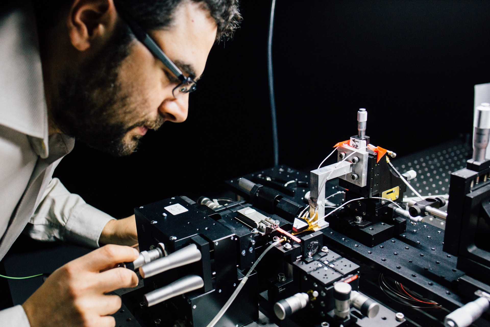 Assoc Prof Mirko Lobino works on the microchip.