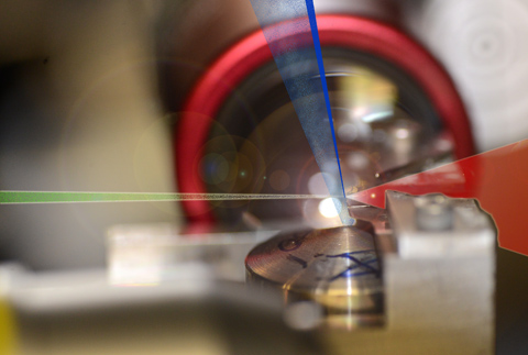 A laser pulse hits helium atoms