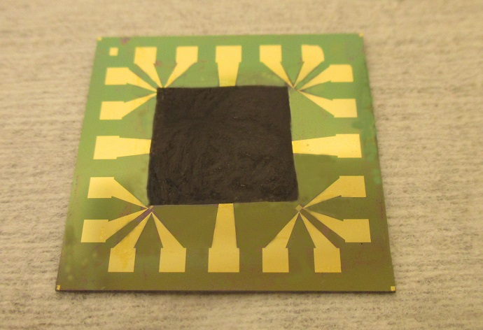 Graphene-based film on an electronic component with high heat intensity