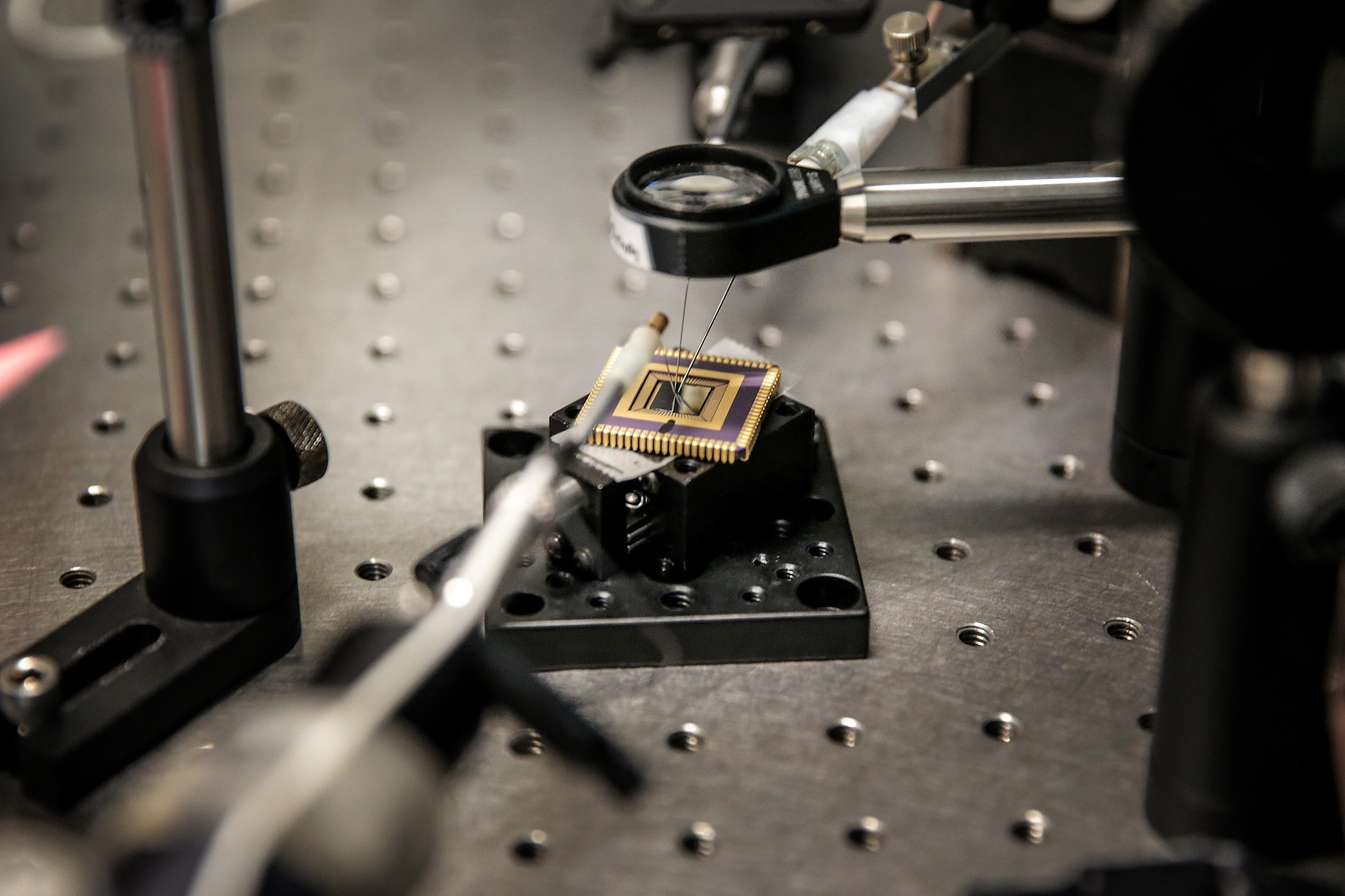 Shrinking photodetectors like this scant wafer held in a frame for testing in the laboratory of UW–Madison engineering Professor Zhenqiang Ma help make consumer electronics smaller