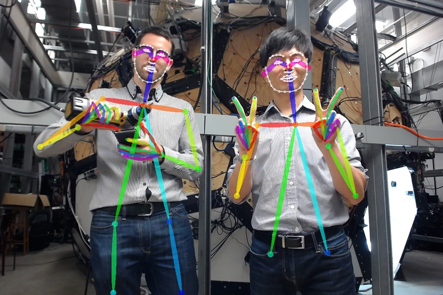 Robotics Institute researchers Gines Hidalgo Martinez and Hanbyul Joo demonstrate how a real-time detector understands hand gestures and tracks multiple people.